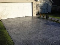 This stamped driveway changed the front of the house. These pictures are a small sample of our work, if you require any more ideas please ask.