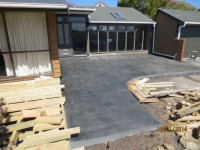 Coloured patio with a hand wipe finish. The hand wipe finish gives a great look and even better grip, once cut into squares the look is outstanding as you can see.